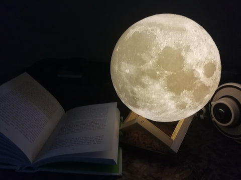 reading book in moon lamp light