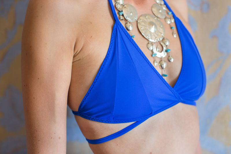 zero waste bikini top w cross over front - electric blue - made in Italy for surfing - Close up Lago di Como villa