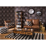 The Warehouse Sofa in room with table, shelves and accessories