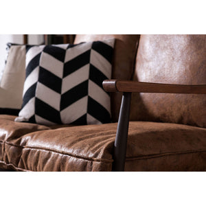 The Warehouse Sofa close up of wooden arm with cushions