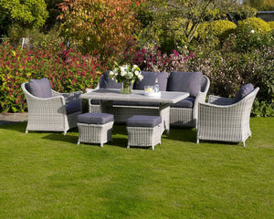Bramblecrest Monterey 3 Seat Sofa Set With Ceramic Dining Table & Armchairs in garden setting