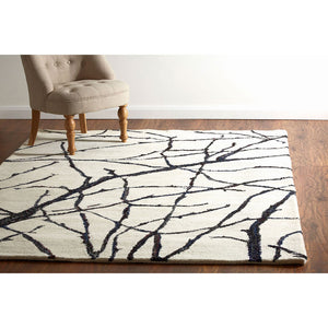 Bosie Branch Print Rug Ivory Tufted Wool / Polyester on floor of house