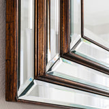 Close-up of Paris mirror bronze edging