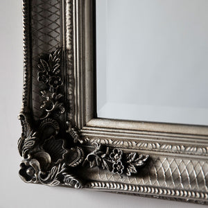 Close up of orante detail on the Silver Ornate Rectangle Mirror