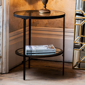 Bronze Side Table in corner of room with book and vase