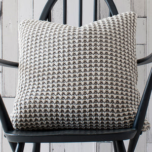 Grey knit cushion