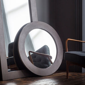 Concrete round mirror leaning