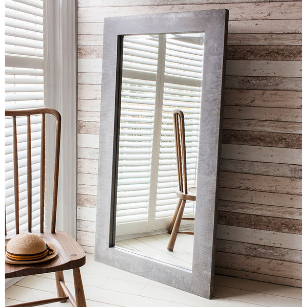 Concrete Leaner Mirror with a chair infront