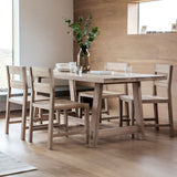 The Serenity Oak Dining Table set with table setting