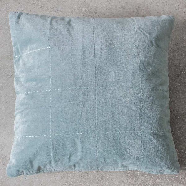 Velvet duck egg cushion on grey background