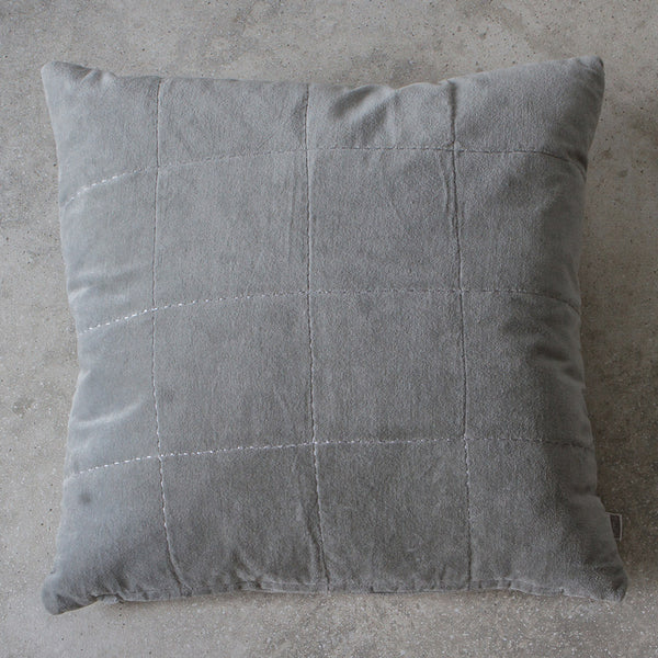 Velvet grey cushion on grey background
