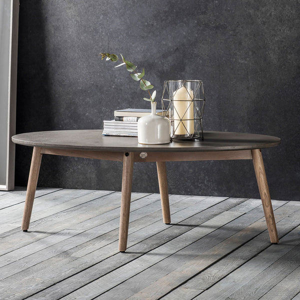 The Tate Oval Coffee Table with candle