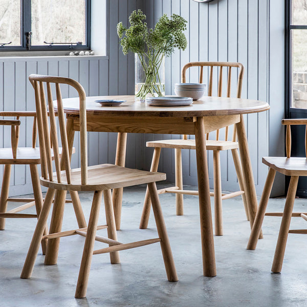 The Bergen Round Extending Dining Table with Dining Chairs
