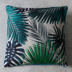 White and green palm leaf cushion on grey background