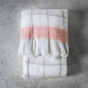 Super soft check throw with blush accent