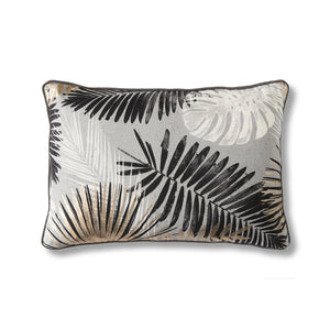 Black, white and gold leaf cushion on white background