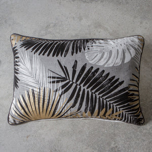 Black, white and gold leaf cushion on grey background