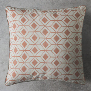 Blush geometric cushion on grey background