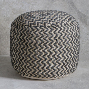 Charcoal chevron pouffe on grey background