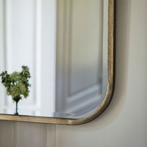 Close-up of Thomas Rectangle Mirror curved corner and champagne frame