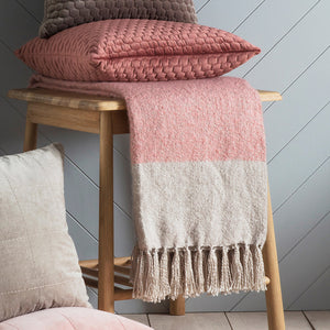 Fringed blush and silver throw