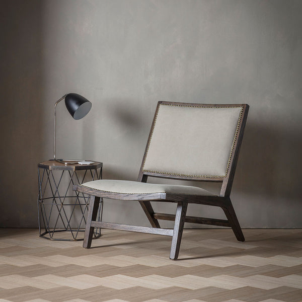 The Stone Washed Bermondsey Chair in situation with side chair and dark accessories