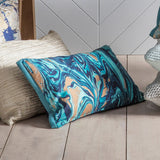 Blue and gold marble cushion in situ with other cushions