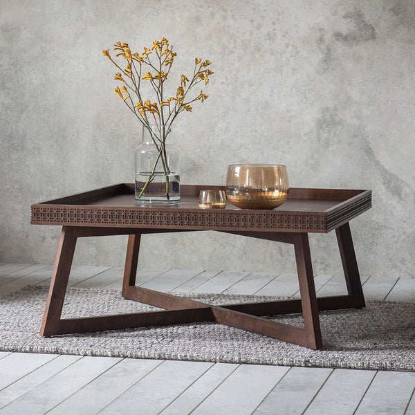 The Chic Brown Coffee Table with vase and ornaments