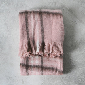 Blush with charcoal check throw on grey background