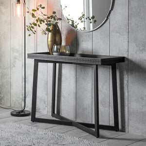 Chic Black Console Table in grey room with mirror on wall