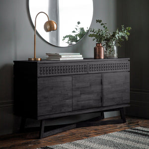 Chic Black 3 Door / 2 Drawer Sideboard in dark room with other furniture and rug