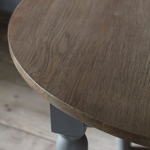 Close-up of rural round oak dining table top