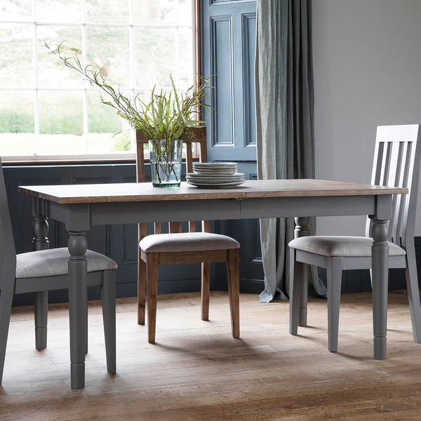 Slate grey Rural Extending Oak Dining Table in situ with 3 slate grey oak dining chairs