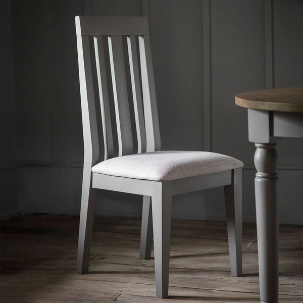 Slate grey Rural Oak Dining Chair in situ next to matching oak dining table