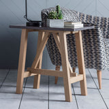 The Ruskin Side Table next to an armchair
