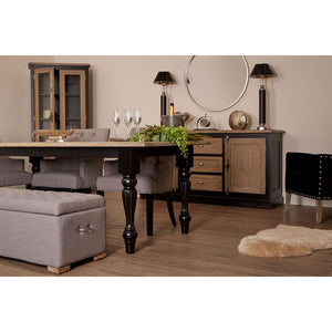 The Shaker Dining Table (2.2m) situated in full room of furniture with accessories and rug