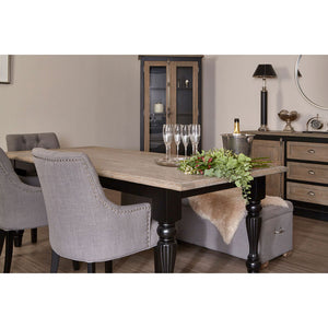 The Shaker Dining Table (2.2m) situated in full room of furniture with accessories from angle view and fruit