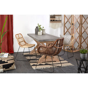 The Nordic Rattan Tub Chair at table with other chairs