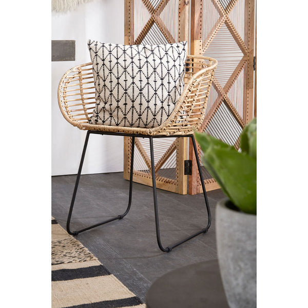 The Nordic Rattan Tub Chair with cushion in room with wooden items