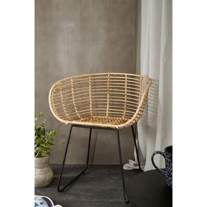 The Nordic Rattan Tub Chair in room with white curtain