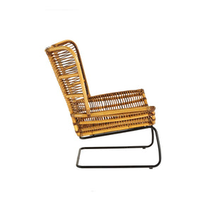 The Nordic Rattan Chair And Footstool side view