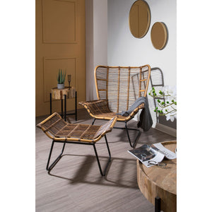The Nordic Rattan Chair And Footstool in room with grey floor and wooden furniture