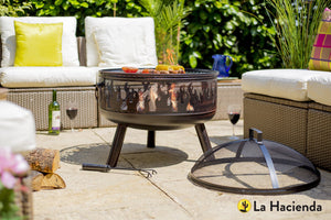 Steel firepit on patio with mesh lid off