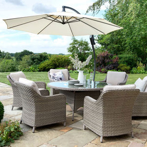 2019 Kettler Charlbury 6 Seat Dining Set from another angle with parasol