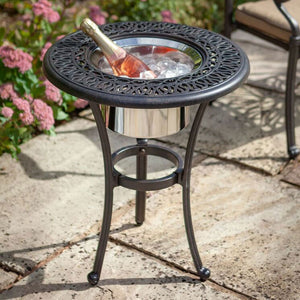 2019 Hartman Amalfi 54cm Round Bistro Table With A Bronze Ice Bucket filled with Ice and a bottle of sparkling wine at the centre - Duplicate