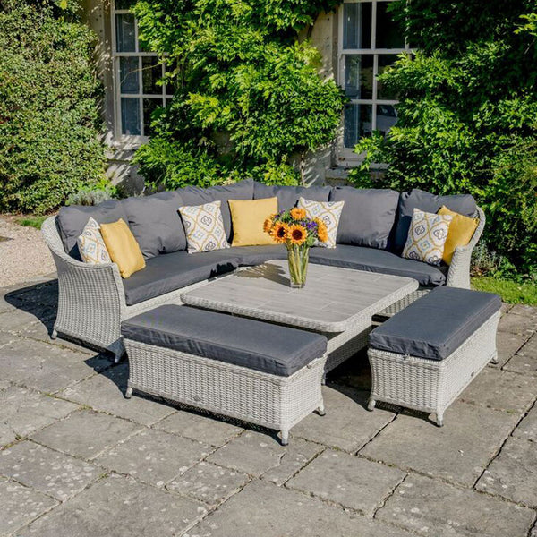 2019 Bramblecrest Monterey Outdoor Sofa Set With Adjustable Square Dining Table on patio on front of house with large plants