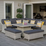 2019 Bramblecrest Monterey Outdoor Sofa Set With Adjustable Square Dining Table with yellow cushions on decking in front of house
