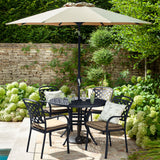 2019 Hartman Berkeley 4 Seater Round Garden Dining Table Set In Situ With 4 Outdoor Dining Chairs And A Solar Parasol - Bronze/Amber