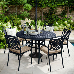 Close Up Of The 2019 Hartman Berkeley 6 Seater Round Garden Dining Table Set In Situ With 6 Outdoor Dining Chairs