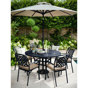 2019 Hartman Berkeley 6 Seater Round Garden Dining Table With Outdoor Dining Chairs And An Open Parasol